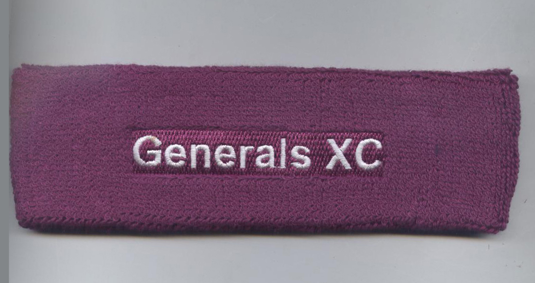 Custom purple head sweatband with white text embroidery